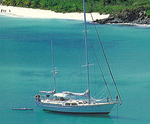 IRIE anchored in White Bay, Jost Van Dyke, BVI in 1998 with Joe and Lynne at the bow