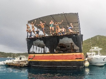 Carefree clients jumping off the new Willy T, Norman Island, BVI